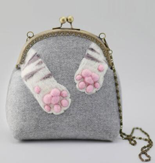 Dezzal: Cat Pads Kiss Lock Crossbody Bag